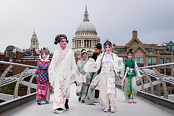 © Licensed to London News Pictures. 26/09/2016. London, UK. Members of the SuZhou Kun Opera theatre attend a press call crossing the Millennium Bridge ahead of the 400th year anniversary special performance of The Peony Pavilion in memory of Tang Xianzu, the 16th century Ming dynasty's master playright, and William Shakespeare.  Held over three nights, the opera, known as China's Romeo and Juliet, will be performed at the Troxy theatre from 28 to 30 September.  Photo credit : Stephen Chung/LNP