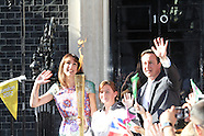 Prime Minister David Cameron and wife Samantha greet Olympic Torch Flame in Downing Street
