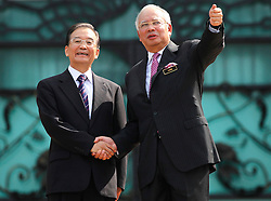 © licensed to London News Pictures. KUALA LUMPUR 28/04/11. Chinese Premier Wen Jiabao (L) shakes hand with the Malaysian prime minister Najib Razak at the prime minister's office in Putrajaya outside Kuala Lumpur on April 28, 2011.Wen began a two-day visit to Malaysia to reaffirm relations and boost economic ties between the two countries. Please see special instructions for usage rates. Photo credit should read Mohd Rasfan/LNP