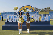 Jul 29, 2018; Costa Mesa, CA, USA; Los Angeles Chargers girls cheerleaders pose with Fight for LA sign during training camp at Jack R. Hammett Sports Complex.