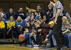 Jan 7, 2017; Morgantown, WV, USA; Former West Virginia Mountaineers player John Flowers reacts to a call during the first half against the TCU Horned Frogs at WVU Coliseum. Mandatory Credit: Ben Queen-USA TODAY Sports
