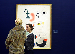 © Licensed to London News Pictures. 31/01/2013. London, UK People stand in front of Joan Miró's .FEMME RÊVANT DE L'ÉVASION. Estimated to raise 8,000,000 - 12,000,000 GBP. Preview of highlights from Sotheby's forthcoming February sales of Impressionist & Modern Art and Contemporary Art in London, including works by Picasso, Bacon, Monet, Richter and Miró. Photo credit : Stephen Simpson/LNP