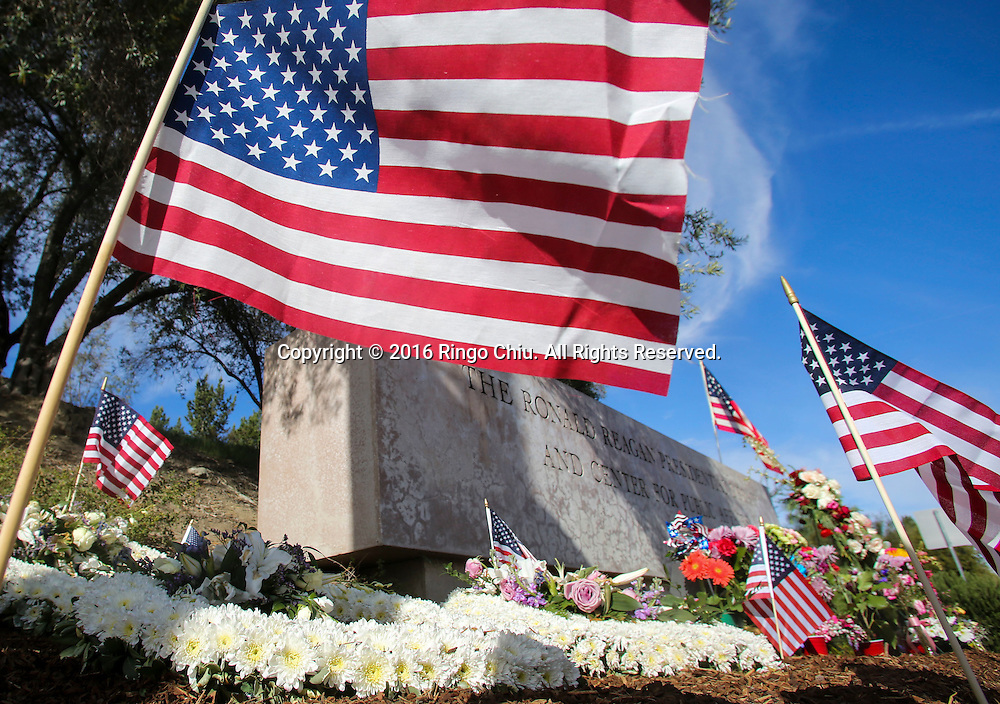 Flowers and flags are placed at a makeshift memorial for the late Nancy Reagan outside the Ronald Reagan Presidential Library in Simi Valley, California on March 10, 2016. Former US first lady Nancy Reagan was lying in repose at her husband's presidential library on, with members of the public paying their last respects ahead of a private funeral. (Photo by Ringo Chiu/PHOTOFORMULA.com)<br /> <br /> Usage Notes: This content is intended for editorial use only. For other uses, additional clearances may be required.