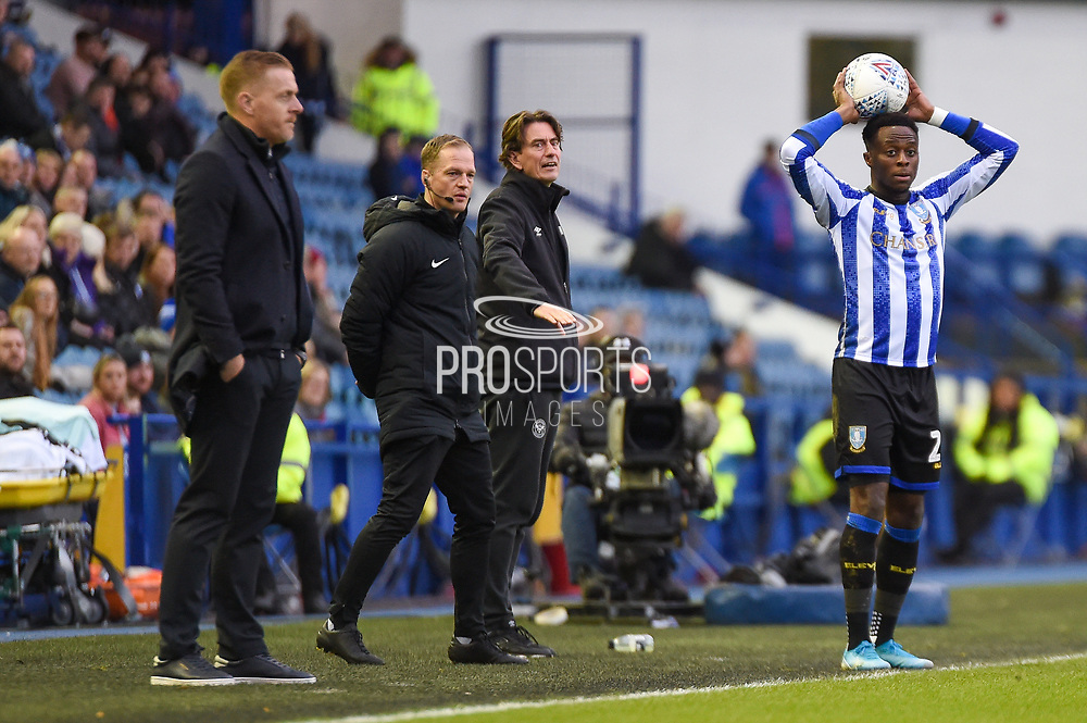 Sheffield Wednesday manager Garry Monk and Brentford FC Head Coach Thomas Frank watch as Moses Odubajo of Sheffield Wednesday talkes a throw in during the EFL Sky Bet Championship match between Sheffield Wednesday and Brentford at Hillsborough, Sheffield, England on 7 December 2019.