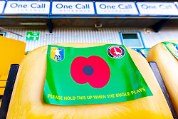 A banner bearing a poppy placed on seats for fans to hold up during the Last Post on Armistice Day at the One Call Stadium, home to Mansfield Town - Mandatory by-line: Ryan Crockett/JMP - 11/11/2018 - FOOTBALL - One Call Stadium - Mansfield, England - Mansfield Town v Charlton Athletic - Emirates FA Cup first round proper