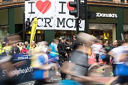 May 28, 2017 - Manchester, Greater Manchester, UK - Manchester , UK . Armed police guard the starting stage of the run at the junction of Portland Street and Oxford Street in Manchester City Centre . The Great Manchester Run 2017 . Security is still heightened in Manchester following a murderous bomb attack at an Ariana Grande gig at Manchester Arena on Monday 22nd May  (Credit Image: © Joel Goodman/London News Pictures via ZUMA Wire)