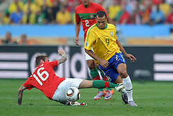 RAUL MEIRELES and LUIS FABIANO in action during the 2010 FIFA World Cup South Africa Group G match between Portugal and Brazil at Durban Stadium on June 25, 2010 in Durban, South Africa.