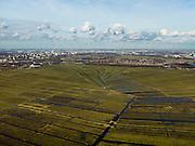 Nederland, Noord-Holland, Gemeente Ouder-Amstel, 20-02-2012; Polder De Ronde Hoep, een van de grootste onbebouwde veenweidegebieden van de Randstad met karakteristiek stervormig kavelpatroon. Dit slotenpatroon van gerende verkaveling is ontstaan in de middeleeuwen ten tijde van de ontginning van het laagveen  (er is ontgonnen vanuit en loodrecht op de omringende riviertjes Amstel, Bullewijk, Waver. Aan de horizon Ouderkerk, Amsterdam Zuid-as en Amsterdam Zuid-Oost..Polder Round Hoep, one of the largest undeveloped pasture area's in the Randstad with characteristic star-shaped pattern. This pattern is the result of the extraction during the Middle Ages. Skyline Amsterdam at the horizon.luchtfoto (toeslag), aerial photo (additional fee required).copyright foto/photo Siebe Swart