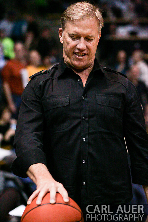 March 3, 2013: Boulder, Colorado - Former NFL quarterback John Elway palms a basketball during halftime of the Colorado Buffaloes game against the University of Oregon Ducks at the Coors Events Center