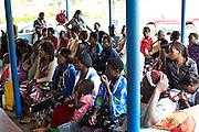Patients wait outside Kasangati Health Centre in Uganda.