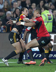Chiefs' Andrew Horrell is challenged by Crusaders' Robbie Fruean in a Super Rugby match, Waikato Stadium, Hamilton, New Zealand, Friday, July 06, 2012.  Credit:SNPA / David Rowland