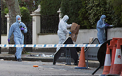 ©  London News Pictures. London, UK. File pic dated 23/04/2013. Forensics examine the scene near the 393 bus on Highbury New Park, north London where teenager Derek Boateng was stabbed to death on his 16th birthday. A teenager has today, 8 November 2013, been convicted of the murder of Derek Boateng at the Old Bailey.  Photo credit: Tolga Akmen/LNP