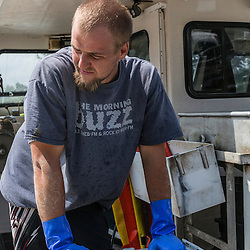 """William Maines, sternman on """"Hunter James"""" at Potts Harbor Lobster in Harpswell, Maine."""
