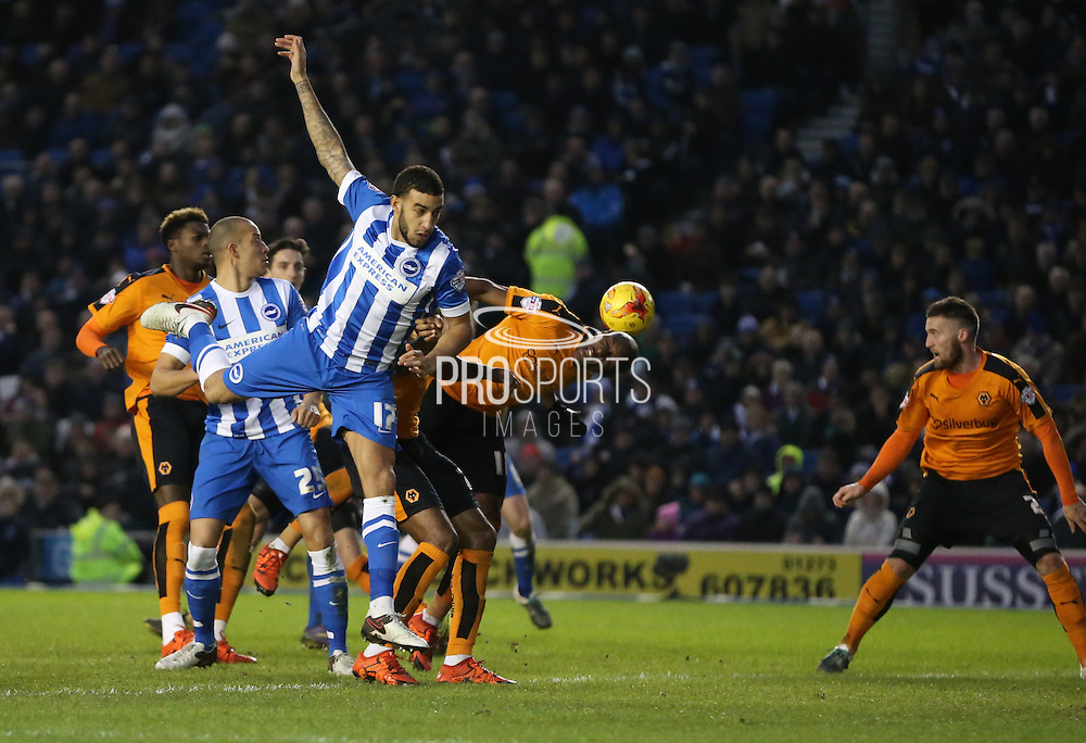 Brighton central defender, Connor Goldson (17) attacks a cross during the Sky Bet Championship match between Brighton and Hove Albion and Wolverhampton Wanderers at the American Express Community Stadium, Brighton and Hove, England on 1 January 2016.