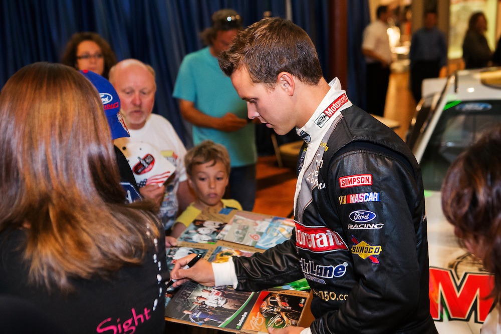 Trevor Bayne signs autographs for fans at Henry Ford 150th Birthday commemoration at The Henry Ford Museum.  Photographed for Ford Racing by KMS Photography