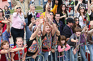Children reach for beads thrown from floats during the 2007 Gasparilla parade in Tampa, Florida.