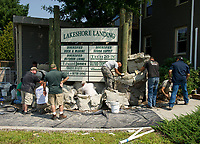 The crew from Clifrock install a waterfall using panel masonry technology outside of Lakeshore Landing with Diversified Dock and Marine / Scuba Supply / Outdoor Living on Friday afternoon.  (Karen Bobotas/for the Laconia Daily Sun)