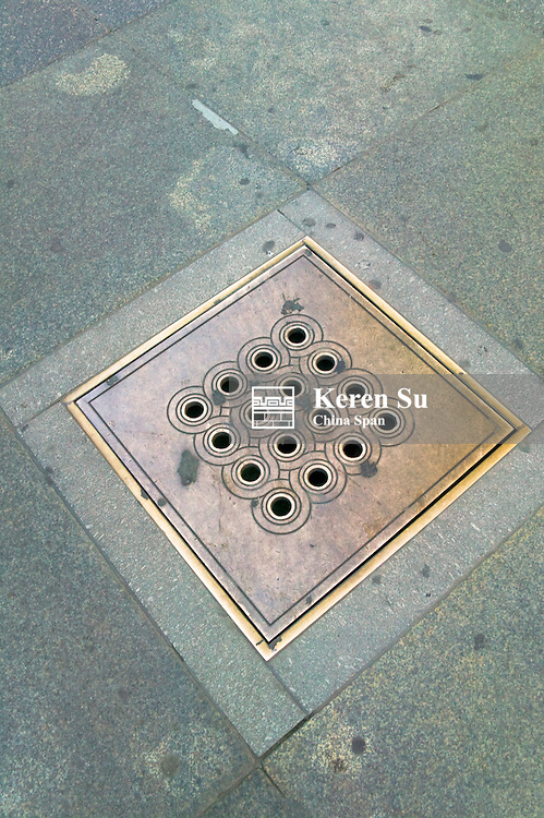 Decorated sewer cover in Prague Castle, Czech Republic