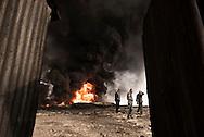 Iraq, Qayyara: Iraqi army fighters walks by a set on fire by IS crude oil field on October 2016. Alessio Romenzi