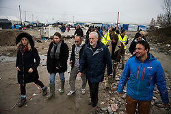 © Licensed to London News Pictures. 23/01/2016. Calais, France. Leader of the Labour Party JEREMY CORBYN (second right at front) visits the camp known as the 'Jungle' in Calais, France, where thousands of migrants and refugees attempting to reach the UK are currently living. Photo credit: Ben Cawthra/LNP