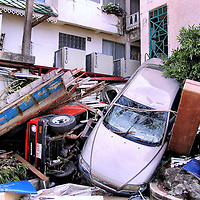 Piled Cars, Taxi and Boat into Hotel After Tsunami on Patong Beach in Phuket, Thailand <br />