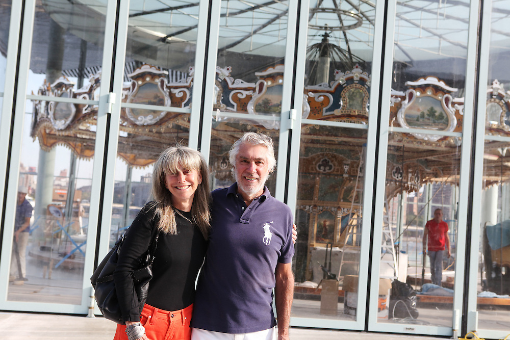 Jane and David Walentas stand outside of Jane's Carousel on September 2, the morning that the horses were brought to the site. The carousel is the work of Mrs. Walentas, who donated the piece to the Brooklyn Bridge Park after years of restoring the carousel to its original splendor. ..CREDIT: Daniella Zalcman for The Wall Street Journal.SLUG: NYJANES