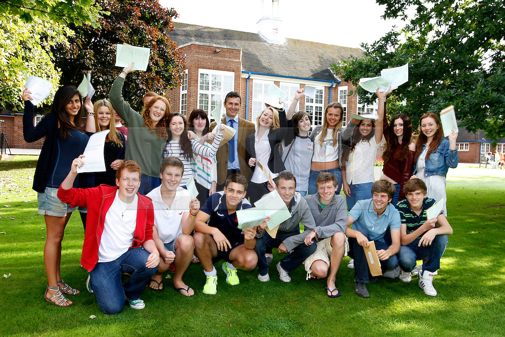 © Licensed to London News Pictures.23/08/2012.Solihull, West Midlands. Pupils celebrating their GCSE results at Solihull School. Pictured.Headmaster David Lloyd, centre,joins jubilant pupils as they celebrate their successes. Photo credit : Dave Warren/LNP