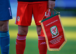 BANGOR, WALES - Saturday, November 17, 2018: Wales' captain Ryan Reynolds holds the match pennant before the UEFA Under-19 Championship 2019 Qualifying Group 4 match between Sweden and Wales at the Nantporth Stadium. (Pic by Paul Greenwood/Propaganda)
