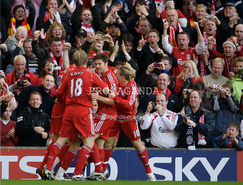 LIVERPOOL, ENGLAND - Sunday, October 28, 2007: Liverpool's captain Steven Gerrard MBE celebrates scoring the opening goal against Arsenal with his team-mates, during the Premiership match at Anfield. (Photo by David Rawcliffe/Propaganda)