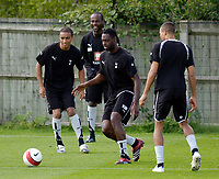 Photo: Daniel Hambury.<br />Tottenham Hotspur training session. 07/09/2006.<br />Spurs captain Ledley King (C) pictured during training. He is due to return to the first team after a long injury lay off.