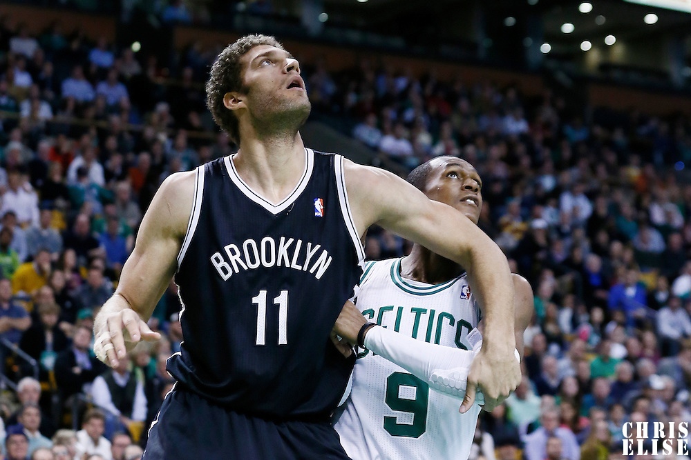 28 November 2012: Brooklyn Nets center Brook Lopez (11) vies for the rebound with Boston Celtics point guard Rajon Rondo (9) during the Brooklyn Nets 95-83 victory over the Boston Celtics at the TD Garden, Boston, Massachusetts, USA.