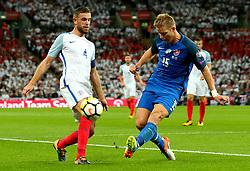 Jordan Henderson of England is tackled by Tomas Hubocan of Slovakia - Mandatory by-line: Robbie Stephenson/JMP - 04/09/2017 - FOOTBALL - Wembley Stadium - London, United Kingdom - England v Slovakia - 2018 FIFA World Cup Qualifier