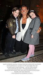 SUZY WILDMAN and her children MAX & ALEXANDRA WILDMAN at an exhibition in London on 6th Aprl 2004.PTD 123