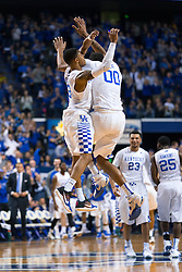 Kentucky forward Marcus Lee, right, and guard Tyler Ulis celebrate strong play in the first half. <br /> <br /> The University of Kentucky hosted the LSU Tigers, Saturday, March 05, 2016 at Rupp Arena in Lexington .