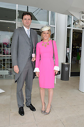 The HON.DOMINIC SPENCER-CHURCHILL and his wife CLAIRE  at the Investec Ladies Day at the Investec Derby Festival 2015 at Epsom Racecourse, Epsom, Surrey on 5th June 2015.
