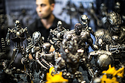© Licensed to London News Pictures . 30/07/2017 . Manchester , UK . Hand-made metal sculptures of science fiction characters for sale . Cosplayers, families and guests at Comic Con at the Manchester Central Convention Centre . Photo credit : Joel Goodman/LNP