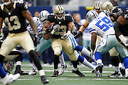 New Orleans Saints running back Pierre Thomas (23) is tackled by the Dallas Cowboys defense at Cowboys Stadium in Arlington, Texas, on December 23, 2012.  (Stan Olszewski/The Dallas Morning News)