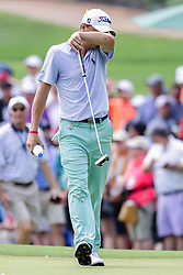 August 12, 2018 - St. Louis, MO, U.S. - ST. LOUIS, MO - AUGUST 12:  Justin Thomas (USA) wipes his face as he walks on the third green during the PGA Championship August 12, 2018, at Bellerive Country Club in St. Louis, MO.  (Photo by Tim Spyers/Icon Sportswire) (Credit Image: © Tim Spyers/Icon SMI via ZUMA Press)
