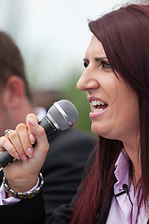 Luton, UK. 27th June, 2015. Jayda Fransen, deputy leader of Britain First, addresses supporters of the far-right group at a rally in Luton. Police failed to prevent leader Paul Golding and Jayda Fransen from attending a march, but ensured that they could not carry banners demanding no more mosques. A counter-protest was organised by Unite Against Fascism.