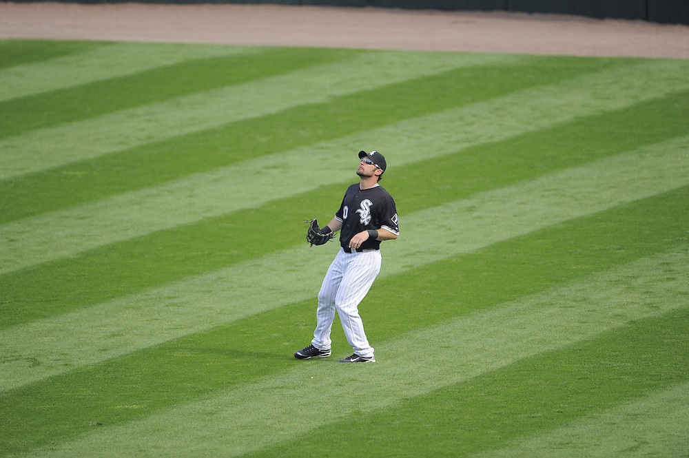 CHICAGO - SEPTEMBER 5:  Mark Kotsay #30 of the Chicago White Sox prepares to catch a fly ball against the Boston Red Sox on September 5, 2009 at U.S. Cellular Field in Chicago, Illinois.  The White Sox defeated the Red Sox 5-1.  (Photo by Ron Vesely)