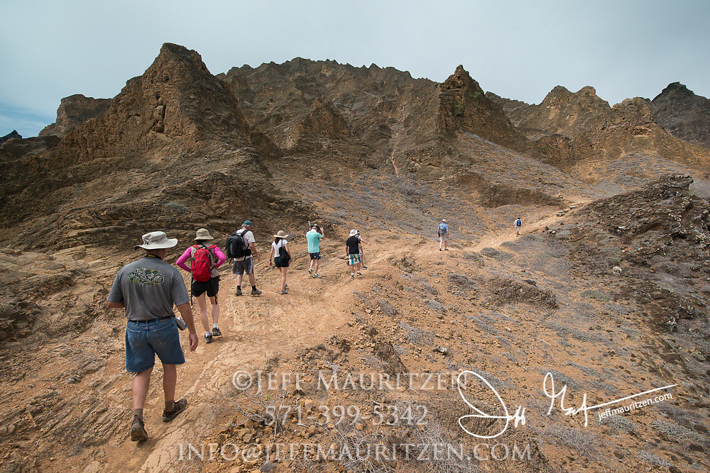 Hikers walk on Punta Pitt at San Cristobal island in the Galapagos archipelago of Ecuador.