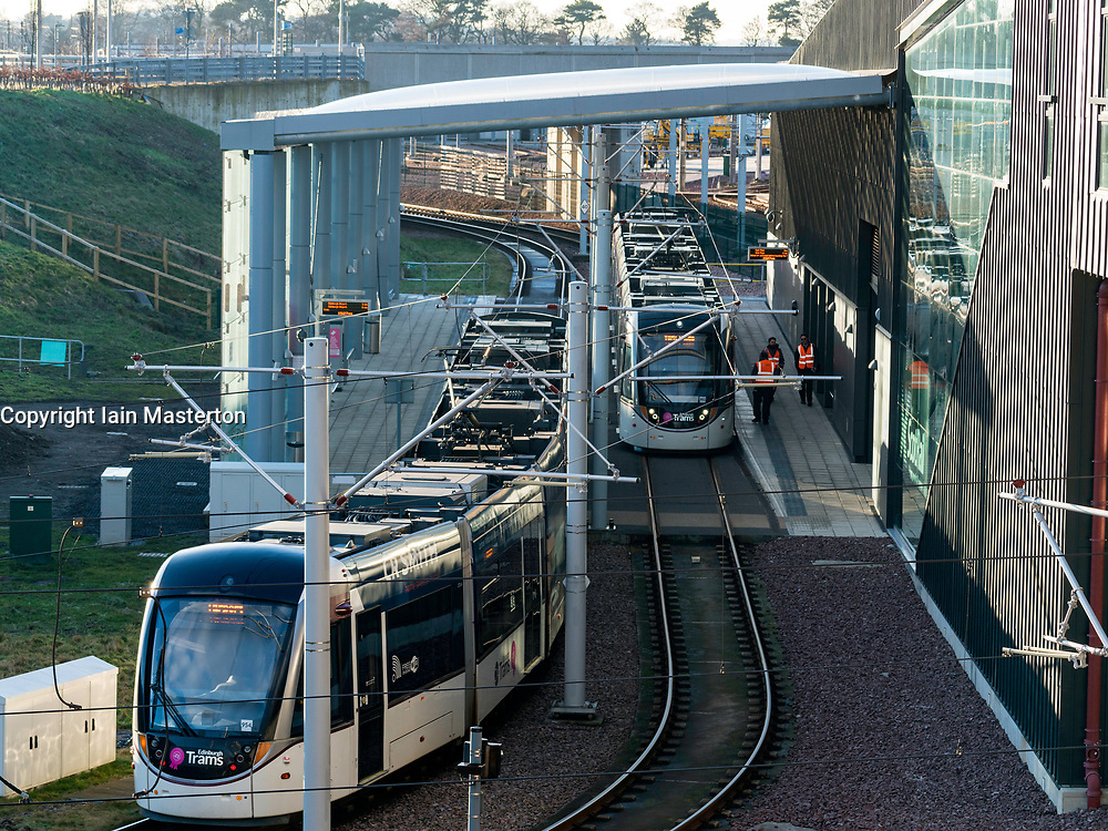 View of trams at platforms at modern Edinburgh Gateway railway and tram station that connects Scotrail train passengers with the Edinburgh Tram link  in Edinburgh, Scotland, United Kingdom.