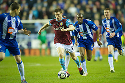 WIGAN, ENGLAND - Tuesday, March 16, 2010: Aston Villa's James Milner in action against Wigan Athletic during the Premiership match at the DW Stadium. (Photo by David Rawcliffe/Propaganda)