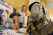 16 MAY 2009 -- PHOENIX, AZ: Rocker and gun owner rights advocate TED NUGENT (LEFT) signs autographs for and talks to RODNEY CONNOR at the NRA convention in Phoenix Saturday. About 60,000 people were expected to attend the trade show at the 138th annual National Rifle Association Annual Meeting in the Phoenix Convention Center in Phoenix, AZ. Photo by Jack Kurtz