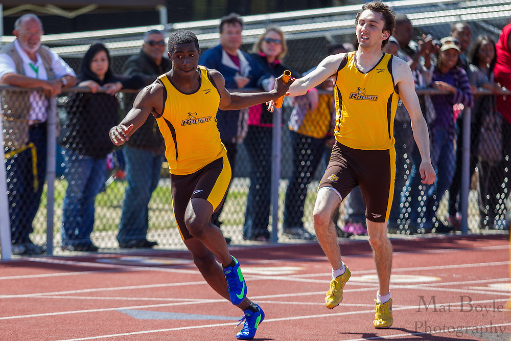 Rowan University's Brandon Taylor (L) and Taylor Purdue competes in the men's 4 x 400 meter relay at the NJAC Track and Field Championships at Richard Wacker Stadium on the campus of  Rowan University  in Glassboro, NJ on Sunday May 5, 2013. (photo / Mat Boyle)