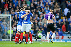 Portsmouth players celebrate but Matt Harrold (ENG) of Bristol Rovers looks dejected after his sides 3-2 loss - Photo mandatory by-line: Rogan Thomson/JMP - 07966 386802 - 19/04/2014 - SPORT - FOOTBALL - Fratton Park, Portsmouth - Portsmouth FC v Bristol Rovers - Sky Bet Football League 2.