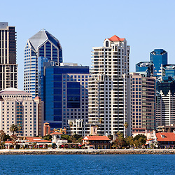 High resolution photo of San Diego skyline close-up with downtown city buildings along the San Diego Bay waterfront in Southern California.