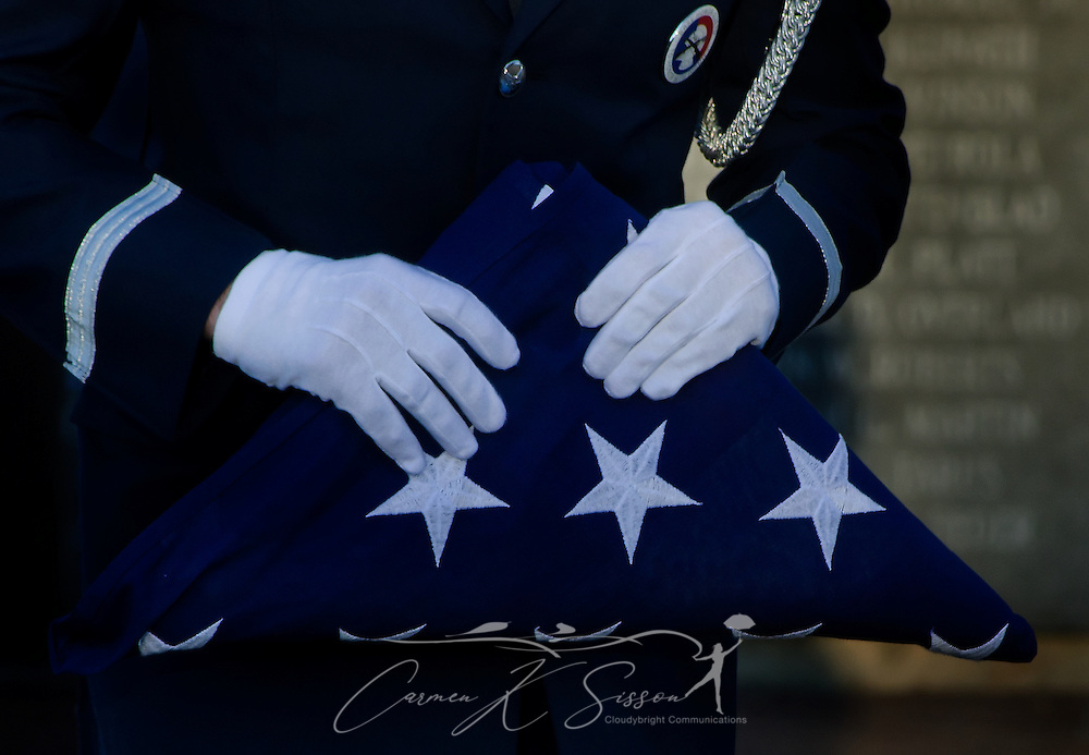 A member of the Columbus Air Force Base Honor Guard carries an American flag during a morning reveille commemorating the Sept. 11, 2001 attacks. (Photo by Carmen K. Sisson/Cloudybright)