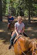 Tourists on guided horseback riding tour at Camp Richardson, near South Lake Tahoe, El Dorado County, California