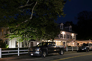 Chatham Wayside Inn hotel with American Chevrolet Silveroo pick-up truck and Jeep parked in front, Cape Cod, New England, USA